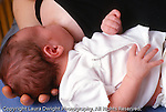 newborn baby boy 1 week old closeup fed nursing at breast horizontal caucasian