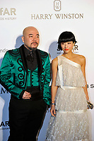 HONG KONG - MARCH 14:  Lyricist Wyman Wong (L) and Actress Hilary Tsui (R) arrive on the red carpet during the 2015 amfAR Hong Kong gala at Shaw Studios on March 14, 2015 in Hong Kong. Photo : Lucas Schifres/Abaca  (Photo by Lucas Schifres/Lucas Schifres)