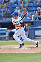 Asheville Tourists left fielder Jacob Bosiokovic (21) swings at a pitch during a game against the Rome Braves at McCormick Field on June 11, 2017 in Asheville, North Carolina. The Braves defeated the Tourists 3-1. (Tony Farlow/Four Seam Images)