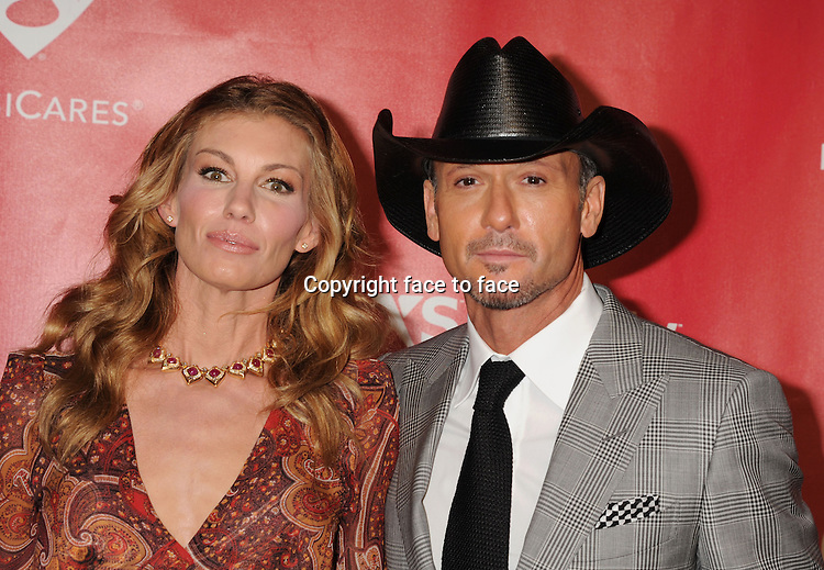 Faith Hill and Tim McGraw arrive at the 2013 MusiCares Person Of The Year Honoring Bruce Springsteen at Los Angeles Convention Center on February 8, 2013 in Los Angeles, California...Credit: Mayer/face to face..- No Rights for USA, Canada and France -