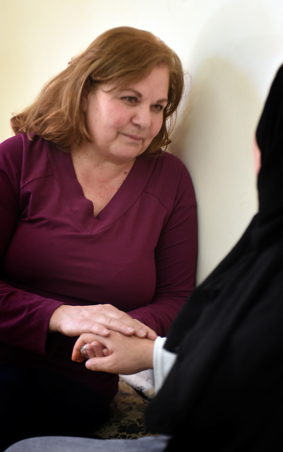 TRAUMA HEALING CASE STUDIES. MARGARET KHABBAZ, TRAUMA HEALING FACILITATOR FOR BIBLE SOCIETY SITS WITH ZUBAIDA FNEISHBI, 37, IRBID, JORDAN. 20/4/16. PHOTO BY CLARE KENDALL.