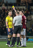 Johnny Mullins of Oxford United & John-Joe O'Toole of Northampton Town are both shown yellow after a tussle during the Sky Bet League 2 match between Oxford United and Northampton Town at the Kassam Stadium, Oxford, England on 16 February 2016. Photo by Andy Rowland.