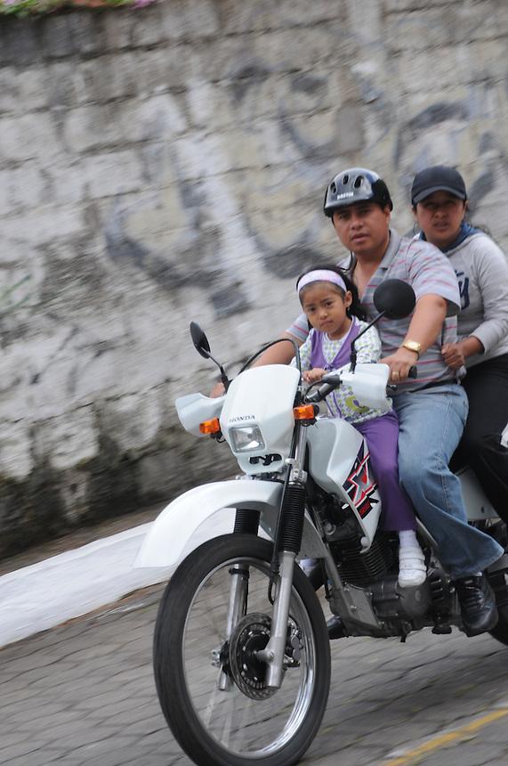 Family on motobike. Banos, Ecuador
