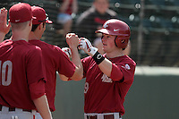 Tommy Richards #9 of the Washington State Cougars is greeted by his teammates during a game against the UCLA Bruins at Jackie Robinson Stadium on March 24, 2012 in Los Angeles,California. UCLA defeated Washington 12-3.(Larry Goren/Four Seam Images)