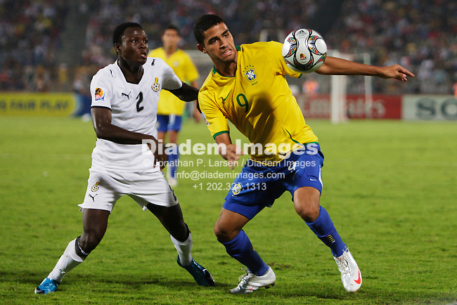 CAIRO - OCTOBER 16:  Samuel Inkoom of Ghana (2) and Alan Kardec of Brazil (9) contest a ball during the 2009 FIFA U-20 World Cup final at Cairo International Stadium on October 16, 2009 in Cairo, Egypt.  Editorial use only.  No pushing to mobile device usage.  Commercial use prohibited.  (Photograph by Jonathan Paul Larsen)