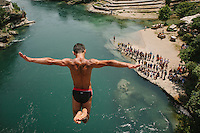 "Igor Kazic, one of the Stari Most diver who usually called ""The Icarus of Mostar"", jump from the old brige into the Neretva River 23 meters below. This old tradition has become a tourist attraction at the Bosnian city of Mostar."
