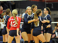 Central Bucks East players celebrate a point against William Tennent during a District One first round volleyball match Tuesday October 27, 2015 in Buckingham, Pennsylvania. (Photo by William Thomas Cain)