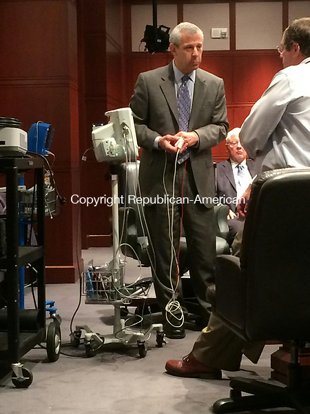HARTFORD, CT- 23 July 2014- 072414AM01- Jonas Pologe, an expert in pulse oximetry and medical devices, shows public health lawyer David Tilles how a CritiCare machine is used during a hearing Wednesday. The same machine was used in Dr. Rashmi Patel's office to monitor a patient who died  while having 20 teeth extracted under conscious sedation. The hearing will determine whether Patel's suspended license remains suspended, is reinstated or is revoked.