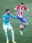 Atletico de Madrid's Kevin Gameiro (r) and FC Barcelona's Gerard Pique during La Liga match. February 26,2017. (ALTERPHOTOS/Acero)