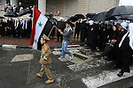 Druze Sheikhs; a young Druze carrying a Syrian flag; and a Druze kid dressed-up as a Syrian soldier, during an annual rally protesting against the 1981 Israeli annexation of the Golan, in the Druze village of Majdal Shams, Golan Heights.