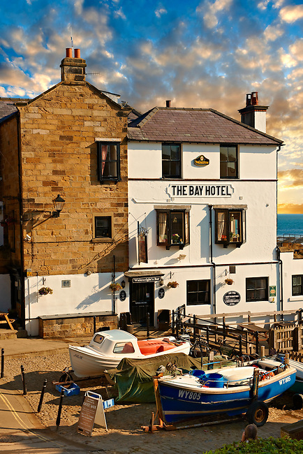 Fishing boats & the Bay Hotel of historic fishing village of Robin Hood's Bay, Near Whitby, North Yorkshire, England.