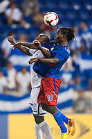 Haiti forward Leonel Saint Preux (18) goes up for a header with Honduras defender Osman Chavez (2). Honduras defeated Haiti 2-0 during a CONCACAF Gold Cup group B match at Red Bull Arena in Harrison, NJ, on July 8, 2013.