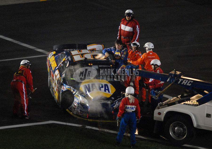 May 20, 2006; Charlotte, NC, USA; Nascar Nextel Cup driver Michael Waltrip (55) is helped from his car after crashing during the Nextel All Star Challenge at Lowes Motor Speedway. Mandatory Credit: Mark J. Rebilas.