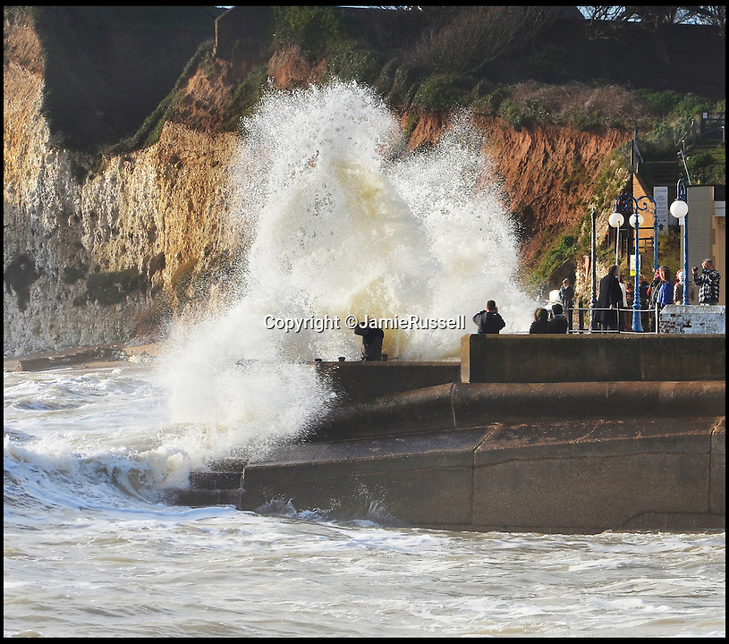 BNPS.co.uk (01202 558833)<br /> Pic: JamieRussell/BNPS<br /> <br /> ***Please Use Full Byline***<br /> <br /> Wave watchers are hit by an oncoming wave at Freshwater bay.<br /> <br /> Stunning photographs have revealed a turbulent side to the normally genteel Isle of Wight.<br /> <br /> The seemingly benign south coast holiday destination has been catalogued over a stormy year by local photographer Jamie Russell, and his astonishing pictures reveal the dramatic changes in weather that roll across the UK in just 12 months.<br /> <br /> Lightning storms, ice, floods, gales and blizzards have all been captured by the intrepid photographer who frequently got up in the middle of the night to capture the climatic chaos.<br /> <br /> Looking at these pictures prospective holidaymakers could be forgiven for thinking twice about a gentle staycation on the south coast island.