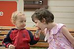 Sausalito CA Boy, two-years-old letting sister, four, sample his popsicle  MR
