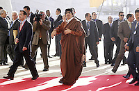 Libyan leader Moamer Kadhafi (c) arrives for a European Union and Africa summit 08 December 2007, in Lisbon.