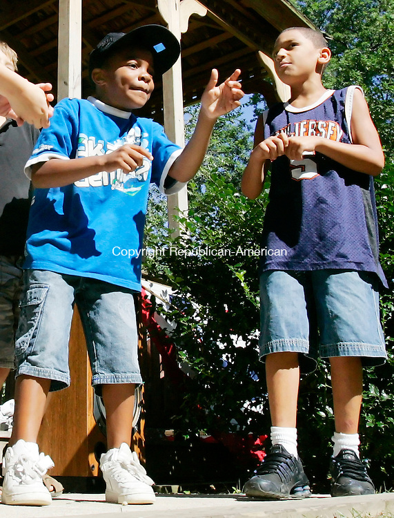 NAUGATUCK, CT. 11 August 2006--081106SV03--From left, Tyrese Henry, 7, and Kevin Armstrong, 9, both of Naugatuck perform a rap song during the Naugatuck YMCA camp talent show on the green in Naugatuck Friday.<br /> Steven Valenti Republican-American