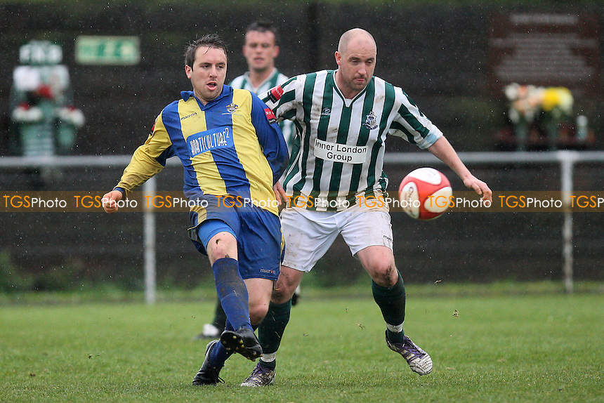 Kurt Smith of Romford evades Dan Trenkel - Great Wakering Rovers vs Romford - Ryman League Division One North Football at Burroughs Park - 28/04/12 - MANDATORY CREDIT: Gavin Ellis/TGSPHOTO - Self billing applies where appropriate - 0845 094 6026 - contact@tgsphoto.co.uk - NO UNPAID USE.