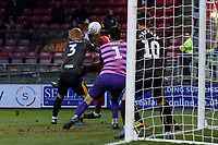 O's Marvin Ekpiteta  heads O's first goal past Tom King during Leyton Orient vs Newport County, Sky Bet EFL League 2 Football at The Breyer Group Stadium on 25th January 2020