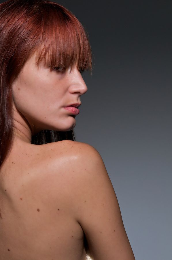 Profile and portrait of a very sensual redhair woman with suggestive looking.