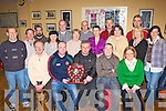 AWARDS NIGHT: Members of the Deer Park Pitch and Putt Club look on as Shane O'Callaghan (seated 2nd left) presents Gerard Casey (seated 3rd left) with the Winter League Trophy at the Deer Park Pitch and Putt awards night in the Kilcummin GAA social club on Friday night.