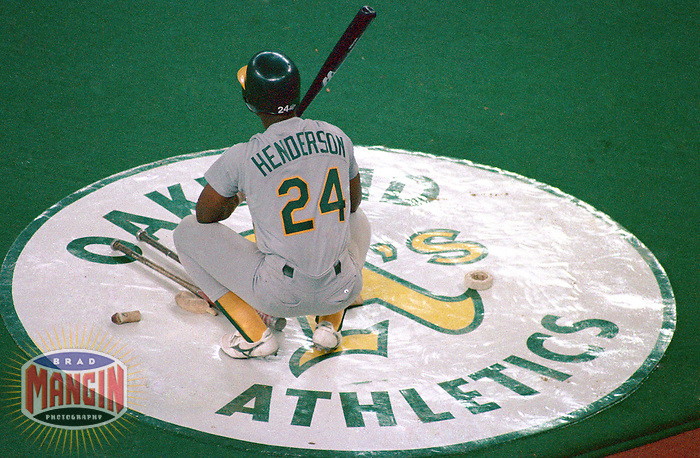 CINCINNATI, OH - Rickey Henderson of the Oakland Athletics waits in the on deck circle during Game 1 of the 1990 World Series against the Cincinnati Reds at Riverfront Stadium in Cincinnati, Ohio in 1990. Photo by Brad Mangin