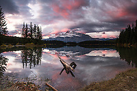Sunrise at Two Jack Lake.  Mount Rundle towers above the Lake and when lucky shares its reflection upon the lake. <br />