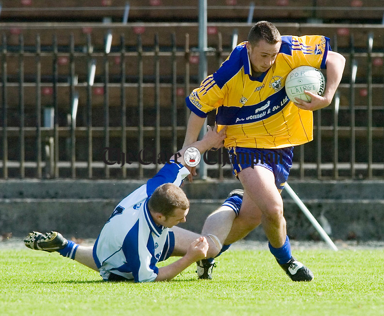 Clare's David Connole leaves Waterford's Shane Biggs in his wake during their senior championship game in Dungarvan. Photograph by John Kelly.