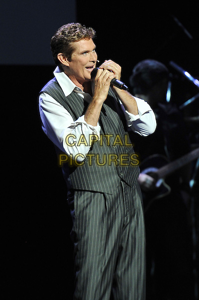 David Hasselhoff .performing live in concert, indigo2, Greenwich, London, England, UK, .3rd March 2012..gig music show on stage half  length grey gray  pinstripe waistcoat white shirt   hand singing microphone .CAP/MAR.© Martin Harris/Capital Pictures.