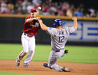 Jul 20, 2008; Phoenix, AZ, USA; Arizona Diamondbacks shortstop Stephen Drew throws to first base to complete a double play after forcing out Los Angeles Dodgers base runner Jeff Kent at Chase Field. Mandatory Credit: Mark J. Rebilas-