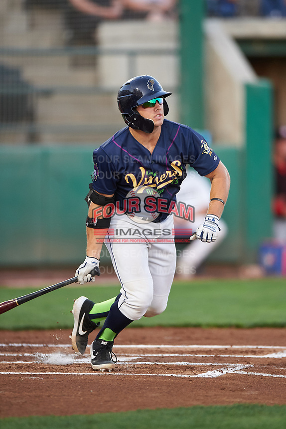 Vineros de Tri-City Logan Driscoll (19) follows through on his swing during a Northwest League game against the Vancouver Canadians at Gesa Stadium on August 22, 2019 in Pasco, Washington. Tri-City defeated Vancouver 2-0. (Zachary Lucy/Four Seam Images)