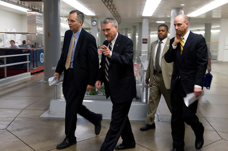"Jon Kyl, D-AZ., makes his way to the Senate Floor via way of the Senate subway for the ""Vote Aroma"" with staffers and security detail  in tow. April 2, 2009."