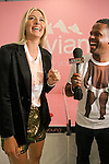 "Maria Sharapova being interviewed by AJ Calloway from Extra TV during the Evian ""Live Young"" photo shoot event hosted by Maria Sharapova at Openhouse Gallery on August 24, 2010."