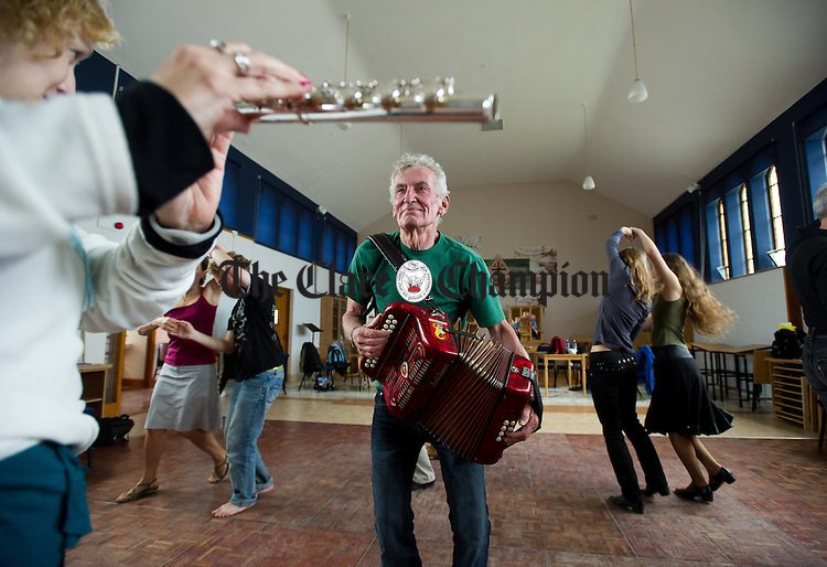 "Dance teacher Timmy, ""The Brit"" Mc Carthy plays for his pupils during the Willie Clancy Week at Miltown Malbay. Photograph by John Kelly."