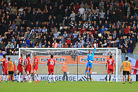 Grimsby goalkeeper James McKeown sees a Cambridge free kic over his bar during the Sky Bet League 2 match between Cambridge United and Grimsby Town at the R Costings Abbey Stadium, Cambridge, England on 15 October 2016. Photo by PRiME Media Images.