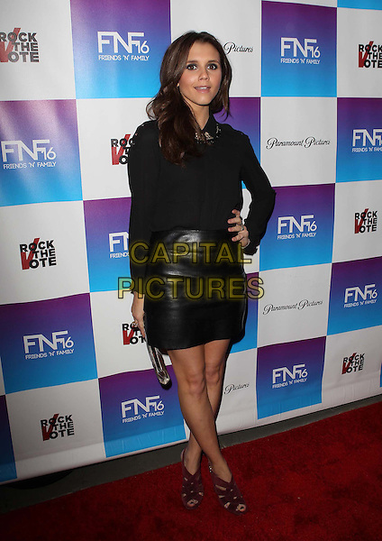 Alexandra Chando.Paramount Studios' 16th Annual Friends 'N' Family Party Held At Paramount Studios, Los Angeles, California,.USA, 8th February 2013..full length black shirt top leather skirt hand on hip .CAP/ADM/KB.©Kevan Brooks/AdMedia/Capital Pictures.