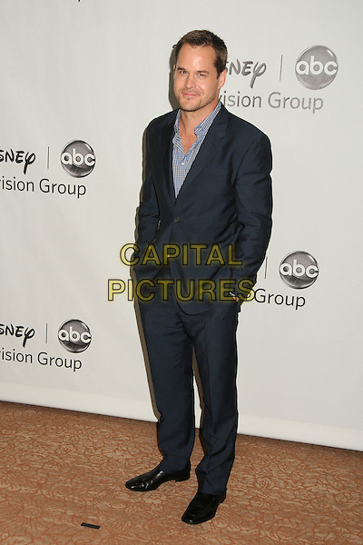 Kyle Bornheimer.Disney ABC Television Group 2012 TCA Summer Press Tour Party held at the Beverly Hilton Hotel, Beverly Hills, California, USA, 27th July 2012..full length blue navy shirt hands in pockets suit .CAP/ADM/BP.©Byron Purvis/AdMedia/Capital Pictures.