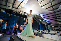 NWA Democrat-Gazette/ANTHONY REYES &bull; @NWATONYR<br /> Hailee Mason, of Fayetteville, does a practice walk Friday, Nov. 6, 2015 before a fashion show at the Springdale Civic Center. Northwest Arkansas Community College is sponsoring the show. It will feature designs from Gatsby's Boutique of Fayetteville, Cinderella's Boutique of Rogers and designs from Raul Rulli Torres, a NWACC graduate. Torres has shown in New York and was featured in Latino Fashion Week 2014 Dallas. All proceeds from the show benefit the college's scholarship fund.