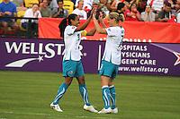 Marta (10) Kelly Smith (7) celebrate after a Marta goal. Marta's X1 defeated Wambach's XI 5-2, June 30, 2010 at the WPS ALL-STAR game. KSU/ Atlanta Beat Stadium in Kennesaw, GA.