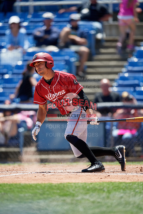 Altoona Curve left fielder Tyler Gaffney (32) hits a single on a swinging bunt during a game against the Binghamton Rumble Ponies on June 14, 2018 at NYSEG Stadium in Binghamton, New York.  Altoona defeated Binghamton 9-2.  (Mike Janes/Four Seam Images)