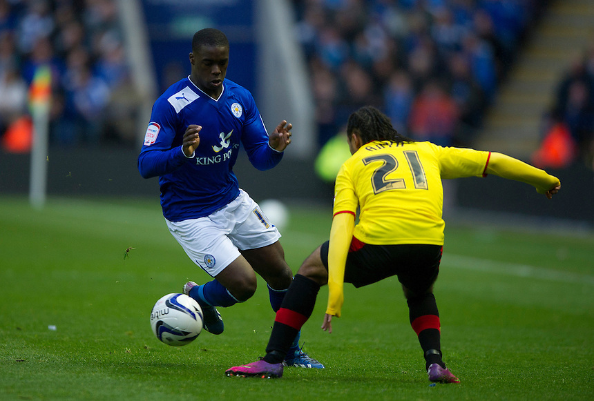 Watford's Ikechi Anya is shown a yellow card for this foul on Leicester City's Jeffrey Schlupp .. - (Photo by Stephen White/CameraSport) - ..Football - npower Football League Championship Play-Offs Semi-Final First Leg - Leicester City v Watford - Thursday 9th May 2013 - King Power Stadium - Leicester..© CameraSport - 43 Linden Ave. Countesthorpe. Leicester. England. LE8 5PG - Tel: +44 (0) 116 277 4147 - admin@camerasport.com - www.camerasport.com
