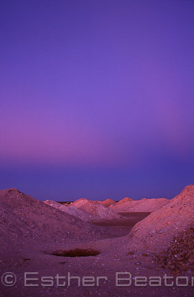 Opal mining dumps or tailings in purple afterglow or twilight. Coober Pedy, South Australia