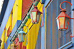 Lamps and brightly painted exteriors of buildings in the La Boca neighborhood of Buenos Aires, Argentina.