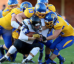 BROOKINGS, SD - SEPTEMBER 20:  TJ Lalley #33 from South Dakota State leads a host of defenders in bringing down Jayden Essman #16 from Wisconsin-Oshkosh in the first half of their game Saturday at Coughlin Alumni Stadium in Brookings. (Photo/Dave Eggen/Inertia)