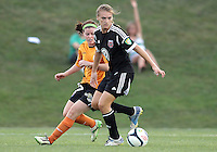 BOYDS, MARYLAND-JULY 07,2012:  Ashley Herndon (19) of DC United Women moves the ball away from Brittany Charles (17) of Dayton Dutch Lions during a W League game at Maryland Soccerplex, in Boyds, Maryland. DC United women won 4-1.