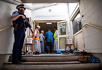 Police constable Nick Banks guards the men's entrance to Wellington Islamic Centre. NZ marks one week since Christchurch terror attacks. Wellington Islamic Centre in Wellington, New Zealand on Friday, 22 March 2019. Photo: Dave Lintott / lintottphoto.co.nz