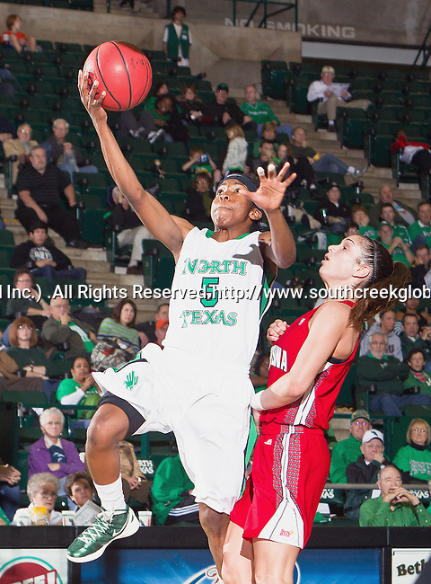 North Texas Mean Green guard Brittney Hudson (5) in action during the game between the Louisiana Lafayette Ragin' Cajuns and the University of North Texas Mean Green at the North Texas Coliseum,the Super Pit, in Denton, Texas. UNT defeats Louisiana Lafayette 78 to 40....