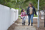 Yanira Lopez walks her daughter Melany home from school in San Antonio, Texas, on November 30, 2015. Lopez and her three children fled Guatemala early in 2015 to escape violence linked to drug trafficking. After requesting political asylum in the United States, they were held for several days by immigration officials and then released. Lopez today volunteers at a shelter for refugee families sponsored by the Refugee and Immigrant Center for Education and Legal Services (RAICES), and supported by a coalition of San Antonio churches. It's the shelter that hosted her and her children when they were released from detention.