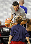 USA's Deron Williams play basket with a kid during training session.July 23,2012(ALTERPHOTOS/Acero)