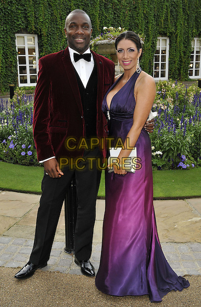 LONDON, ENGLAND - AUGUST 28: Derek Redmond &amp; guest attend the Mo Farah Foundation &quot;A Night Of Champions&quot; Dinner, The Hurlingham Club, Ranelagh Gardens, on Thursday August 28, 2014 in London, England, UK. <br /> CAP/CAN<br /> &copy;Can Nguyen/Capital Pictures
